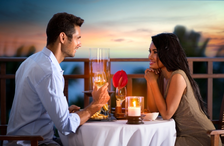 couple on summer evening having romantic dinner