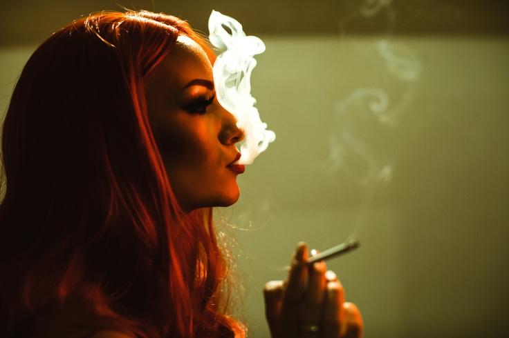 Beautiful woman smokes cigarette